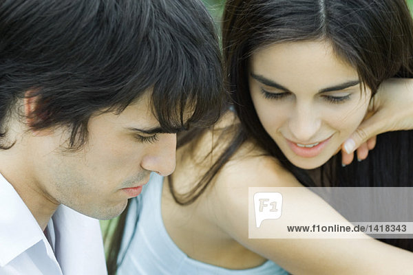 Young couple together  looking down
