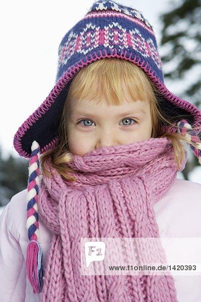 Girl wearing scarf looking at camera