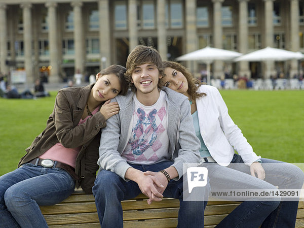 Germany  Stuttgart  young people sitting on bench