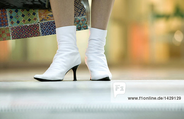 Woman wearing half-boots  low section