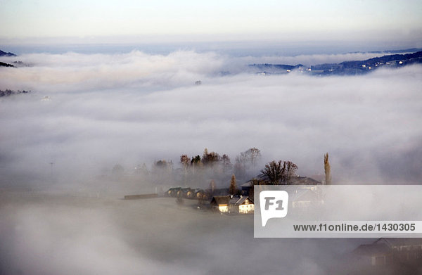 Austria  Salzkammergut  Farmhouses in fog