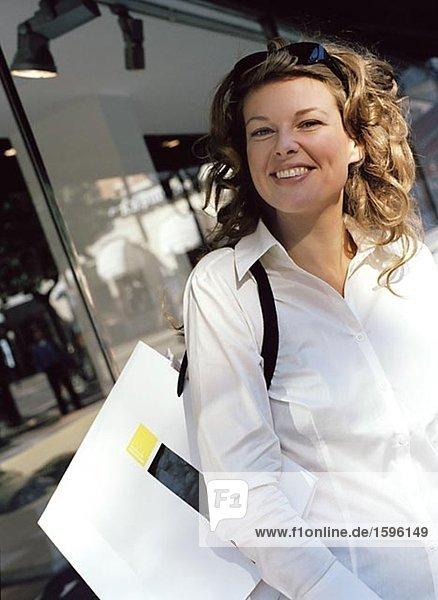 A smiling woman shopping.