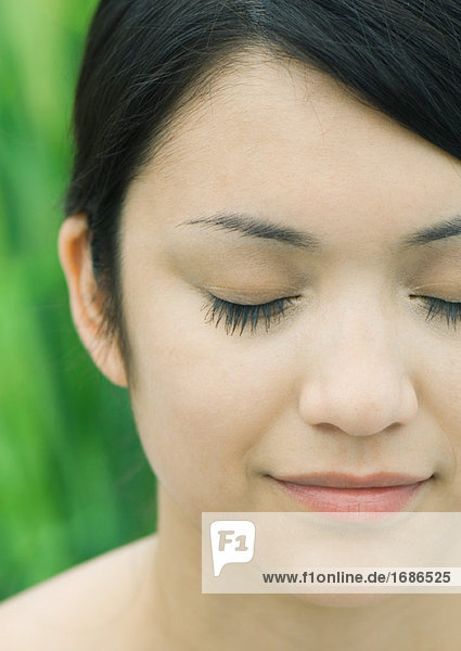 Woman's face  eyes closed  extreme close-up