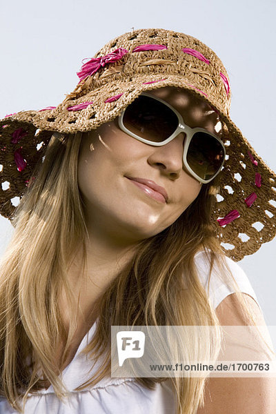 Young woman wearing straw hat  portrait