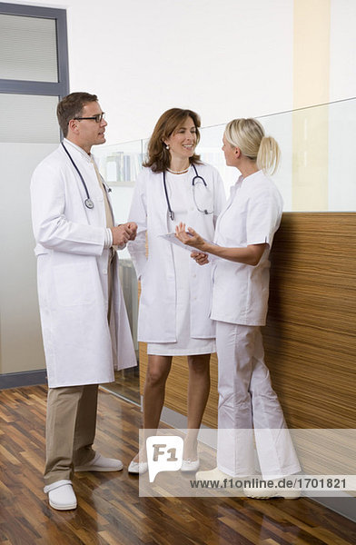 Doctors talking with nurse