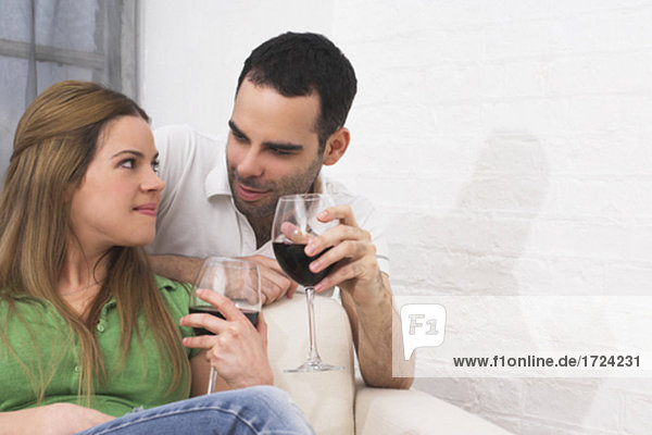 young couple drinking red wine together