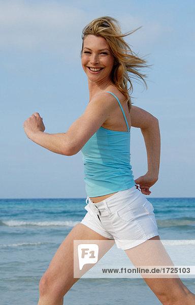 Jogging woman at the sea