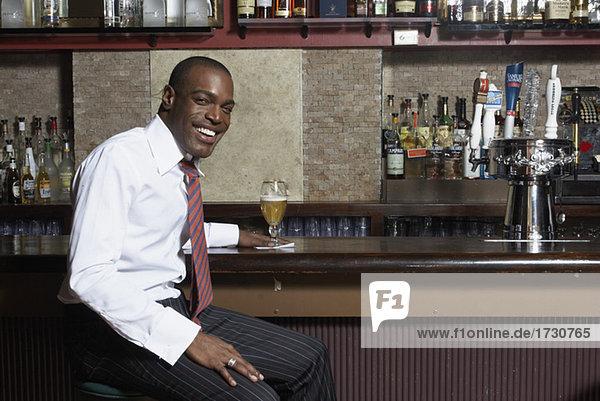 Businessman sitting at Bar