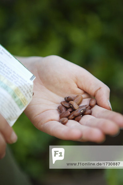 Woman holding seeds