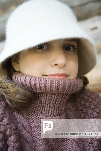 Teenage girl wearing hat and turtleneck,  close-up,  portrait