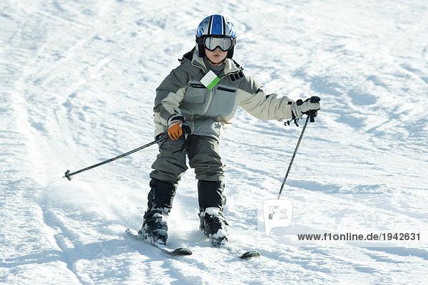 Boy skiing down hill  full length