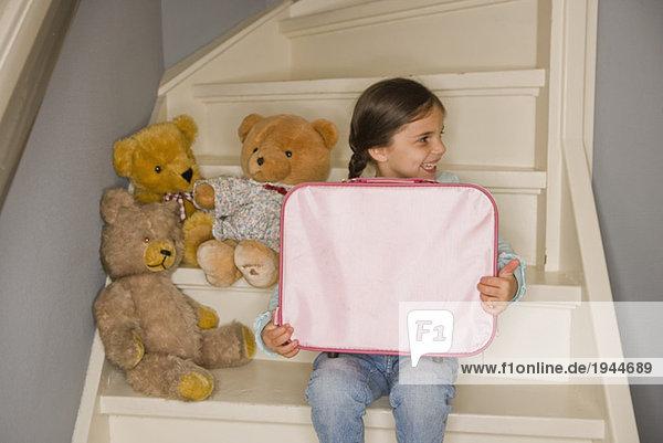 Young Girl playing Teddy bears
