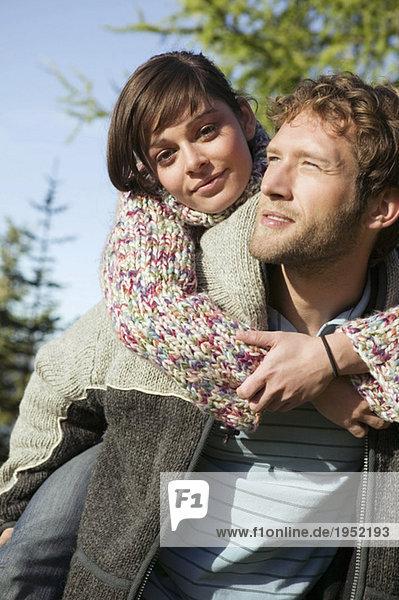 Young couple  woman embracing man