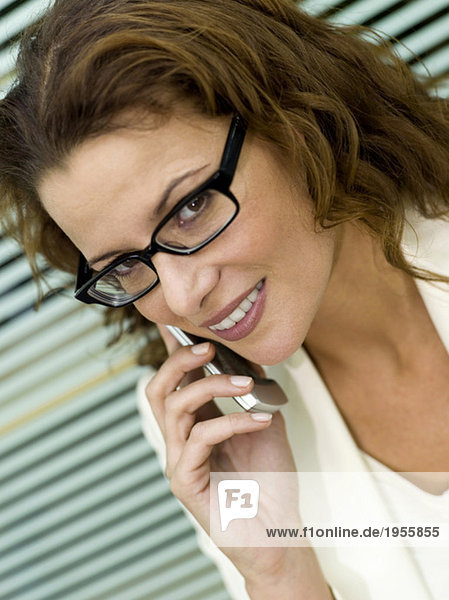 Businesswoman using mobile phone  close-up