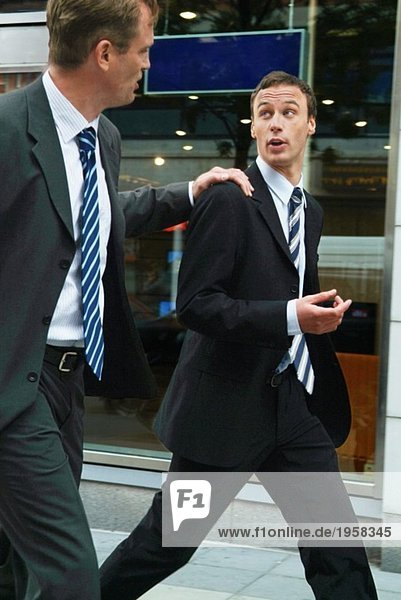Two businessmen on a fast walk