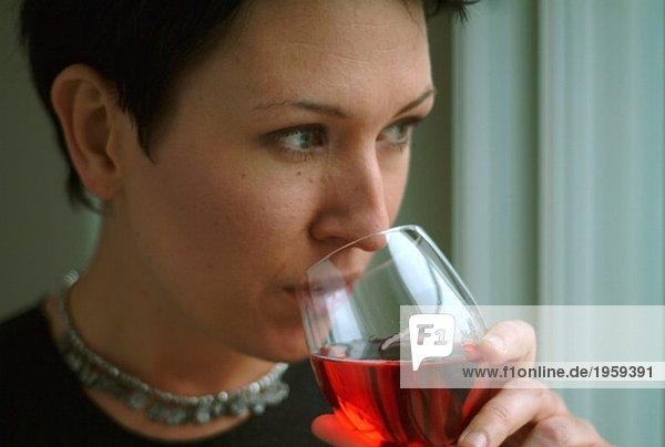 Woman drinks out of wine glass