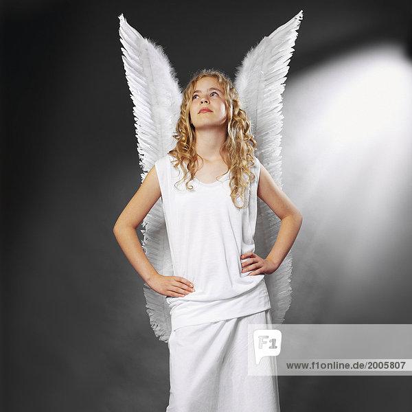 Mädchen als Engel mit Flügeln