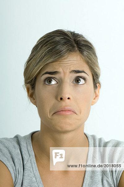 Frau macht trauriges Gesicht  Porträt