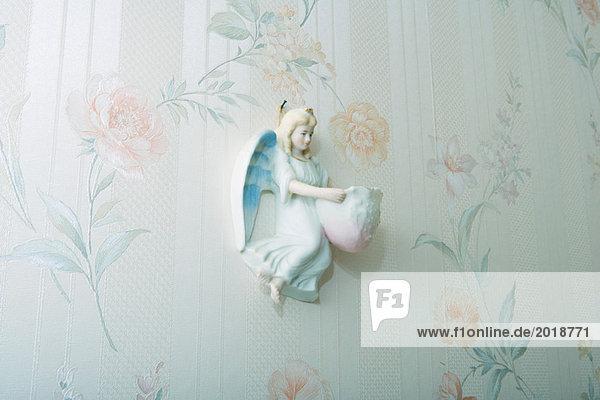 Angel knickknack hanging on wall