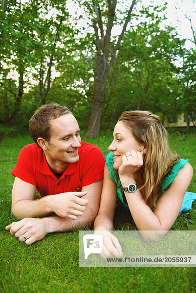 Girl and guy smiling towards each other