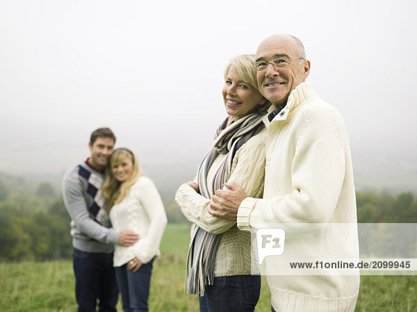 Germany  Baden-Württemberg  Swabian mountains  Smiling couples hugging each other.