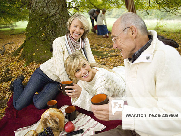Germany  Baden-Württemberg  Swabian mountains  Three generation family having picnic in forest
