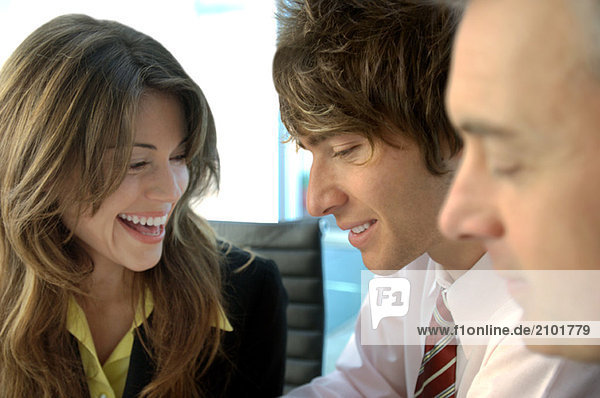 Business people smiling in office  close-up
