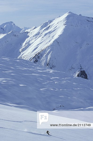 Young woman skiing fresh powder at Mica Heliskiing  Mica Creek  British Columbia  Canada
