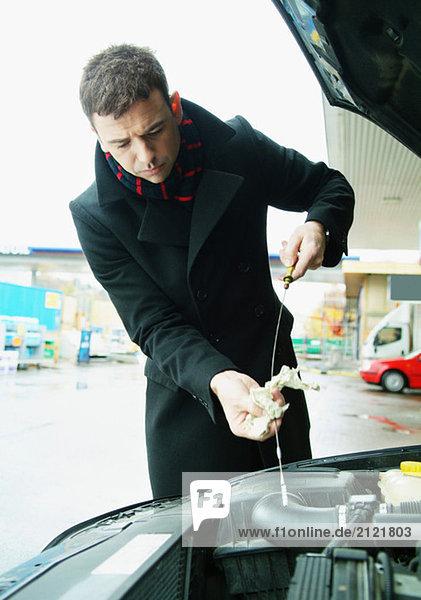 Man checking oil level