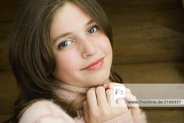 Teen girl smiling at camera  portrait