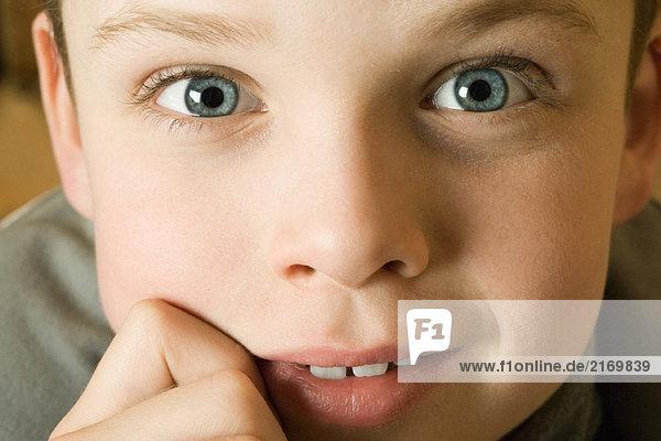 Boy's face  looking at camera  close-up