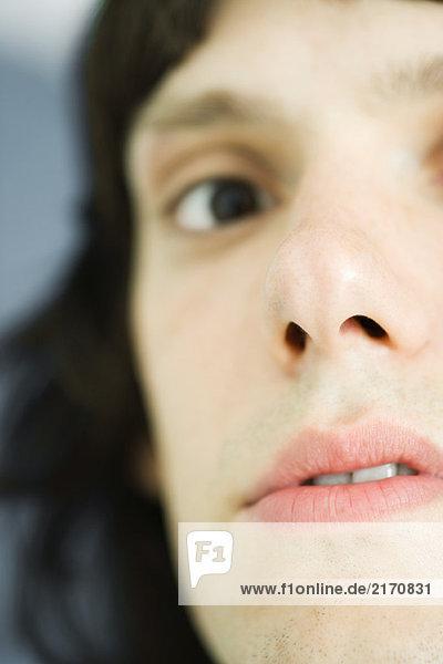 Teenage boy looking at camera  close-up  cropped view