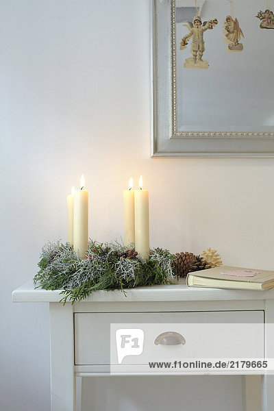Lit candles on Christmas wreath