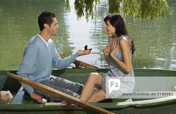 Man proposes to woman in boat