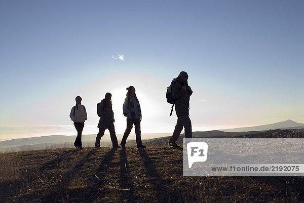 4 people on a trek.