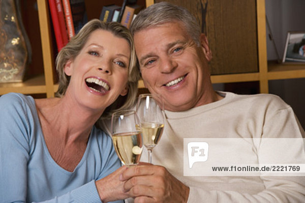 headshot of mature couple with champagne glasses