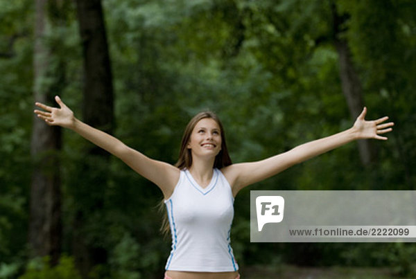 Portrait of happy young Woman im park