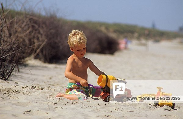 boy - playing in sand