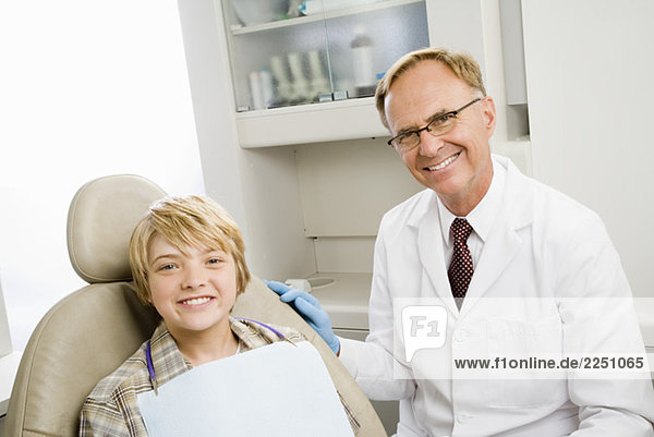 Male dentist and boy in dentist's office