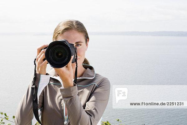 Frau nehmen photographie