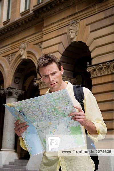 Man looking at map in a city.