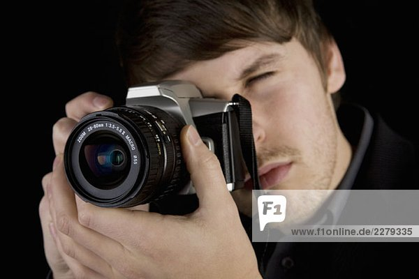 A man taking a photograph