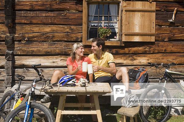 Austria  Salzburger Land  Young couple toasting