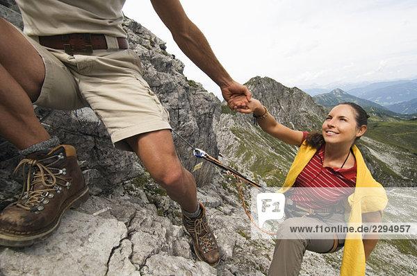 Austria  Salzburger Land  couple mountain climbing