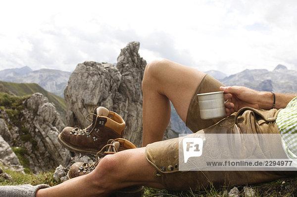 Austria  Salzburger Land  young man relaxing