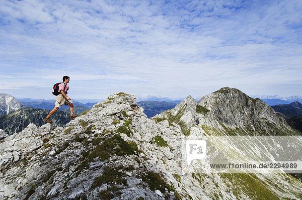 Austria  Salzburger Land  young man hiking