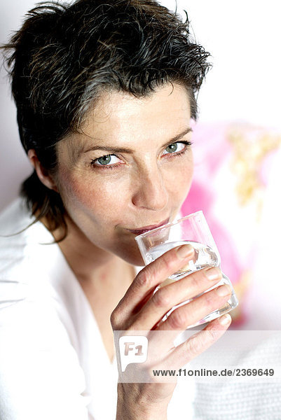 Woman over forty drinking water