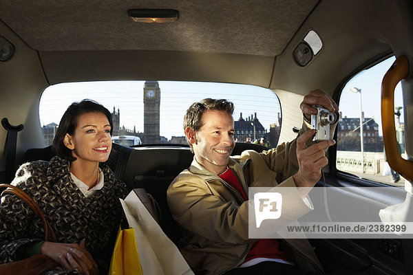 Couple in London taxi  Big Ben in view