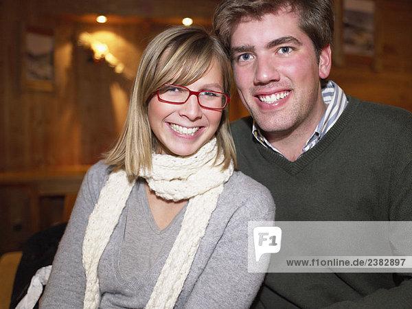 Smiling couple in restaurant