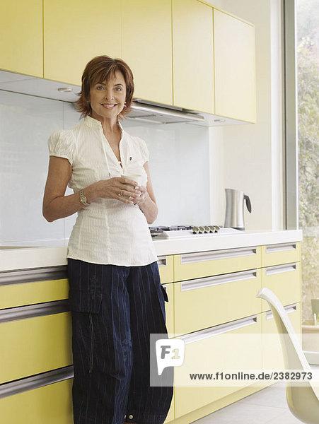 Senior woman standing in kitchen